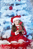 Cute girl and Christmas Tree Royalty Free Stock Images