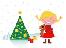 Cute girl with christmas tree and gifts Stock Photo