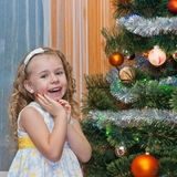 Cute girl with Christmas tree Stock Image