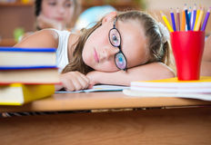 Cute girl in classroom at school Stock Image