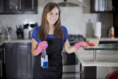 Cute girl cleaning the kitchen Royalty Free Stock Image