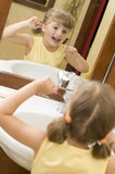 Cute girl cleaning teeth by floss Royalty Free Stock Photos