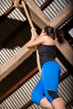 Cute girl climbing a rope Royalty Free Stock Photo