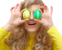 Cute girl closes her eyes with eggs Royalty Free Stock Photography