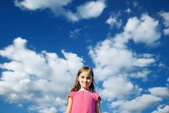 Cute girl on a cloudy background Royalty Free Stock Images