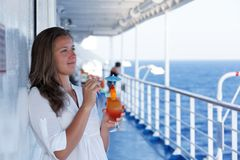 Cute girl with a cocktail on a journey Royalty Free Stock Photography