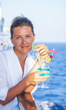 Cute girl with a cold cocktail, enjoy the rest of the cruise Stock Photos