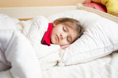 Cute girl with cold sleeping under blanket Royalty Free Stock Photos