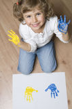 Cute girl with colored hands.  Royalty Free Stock Image