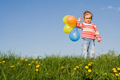 Cute girl with colorful balloons, copyspace Royalty Free Stock Photos