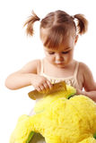 Cute girl combing her soft toy Stock Photography