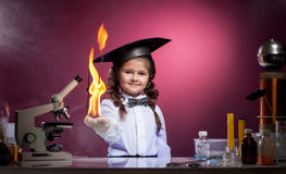 Cute girl conducts physical experience in lab Stock Photos