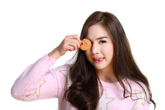 Cute girl with cookie. Royalty Free Stock Images