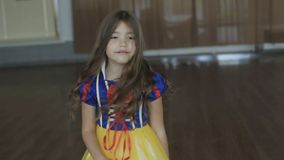 Cute girl in costume of the Thumb Princess posing at camera. Full HD stock footage