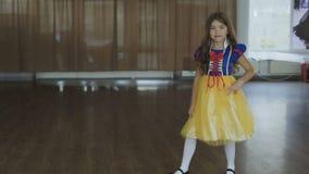 Cute girl in costume of the Thumb Princess posing at camera. Full HD stock video