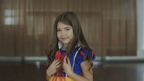 Cute girl in costume of the Thumb Princess posing at camera. Full HD stock video footage