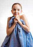 Cute girl covering in blue towel after swimming Royalty Free Stock Photos