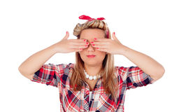 Cute girl covering her eyes in pinup style Royalty Free Stock Image