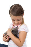 Cute girl cuddling grey kitten Royalty Free Stock Photos