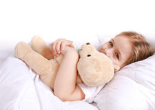 Cute girl cuddling with teddy bear. To sleep Royalty Free Stock Photos