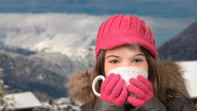Cute girl with a cup of tea in mountain village Stock Images