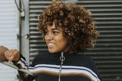 Cute girl with curly hair royalty free stock photos