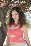 Cute girl with curly hairs pose outdoor in the nature Royalty Free Stock Photos