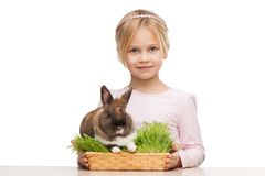 Cute girl with cute bunny in grass Stock Images