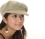 Cute Girl in a Cute Hat. Girl in a hat royalty free stock photo