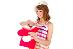 Cute girl cutting valentine heart Royalty Free Stock Photos