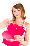Cute girl cutting valentine heart Royalty Free Stock Images