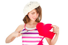 Cute girl cutting valentine heart Royalty Free Stock Photography