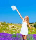 Cute girl dancing on lavender field Royalty Free Stock Images