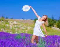 Cute girl dancing on lavender field Royalty Free Stock Photos