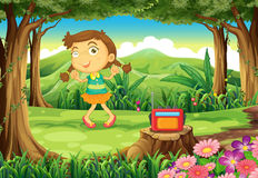 A cute girl dancing in the middle of the woods Royalty Free Stock Photo