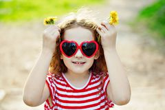 Cute girl showing thumbs up. Royalty Free Stock Photography