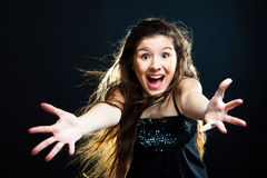 Cute girl with dark long hair shouting on black Royalty Free Stock Photo
