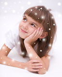 Cute girl is daydreaming Royalty Free Stock Image