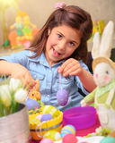 Cute girl decorate Easter eggs Stock Image