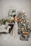 Cute girl decorates Christmas tree Stock Photography
