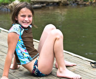 Cute Girl on a Dock Royalty Free Stock Images