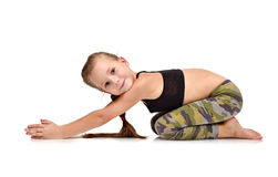 Cute girl does exercise. On white background Royalty Free Stock Photography