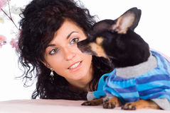 Cute girl with dog Stock Images