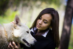 Cute girl with a dog in the forest Stock Photography