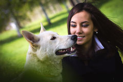 Cute girl with a dog in the forest Stock Photos