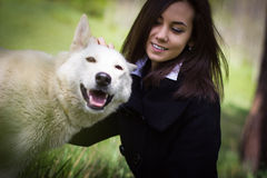 Cute girl with a dog in the forest Royalty Free Stock Photo