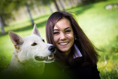 Cute girl with a dog in the forest Stock Image