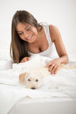 Cute girl and dog in the morning Royalty Free Stock Image