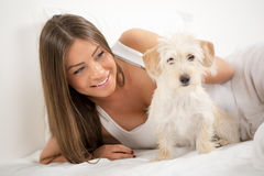 Cute girl and dog in the morning stock image