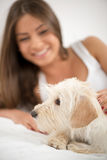 Cute girl and dog in the morning Stock Photography